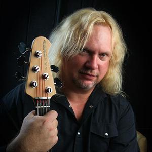 Bruce J. Bennett plays a Lakland Skyline Series 55-02 five string bass