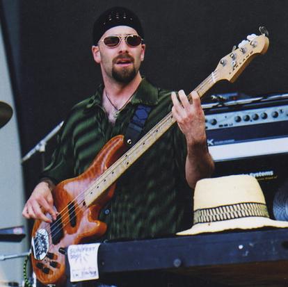 Benj-LeFevre playing a lakland bass