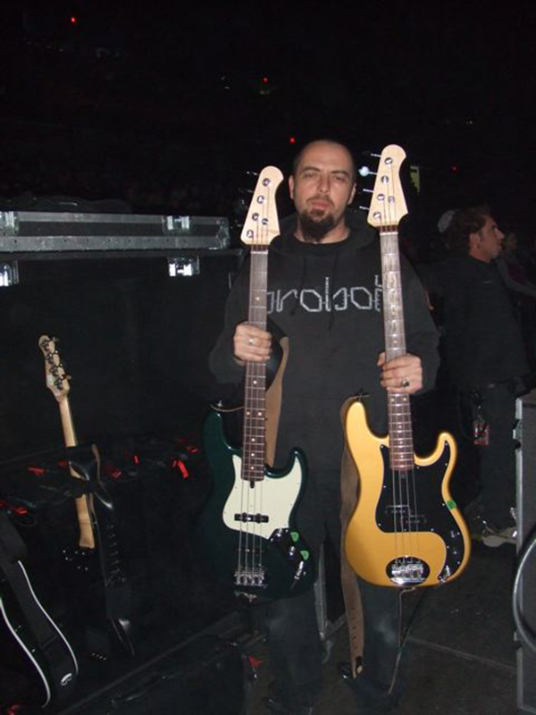 Geoff Templeton holding lakland basses