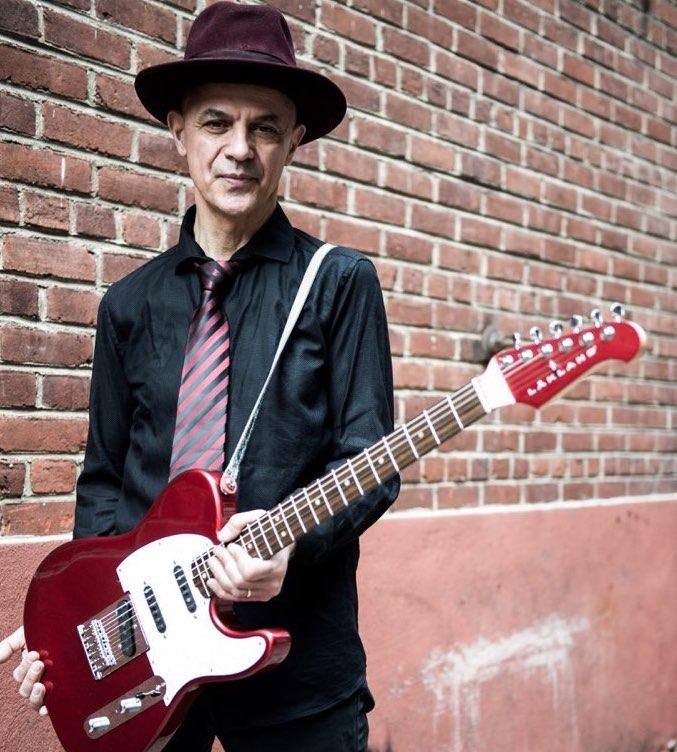 James Mastro holding a lakland guitar